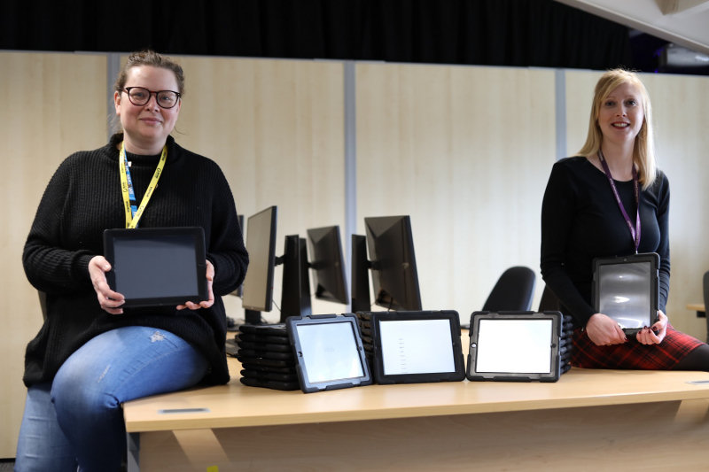 The Trust's charity and engagement facilitator, Nicola Brockley, is pictured collecting the iPads from Shelley George at Telford College's Haybridge campus