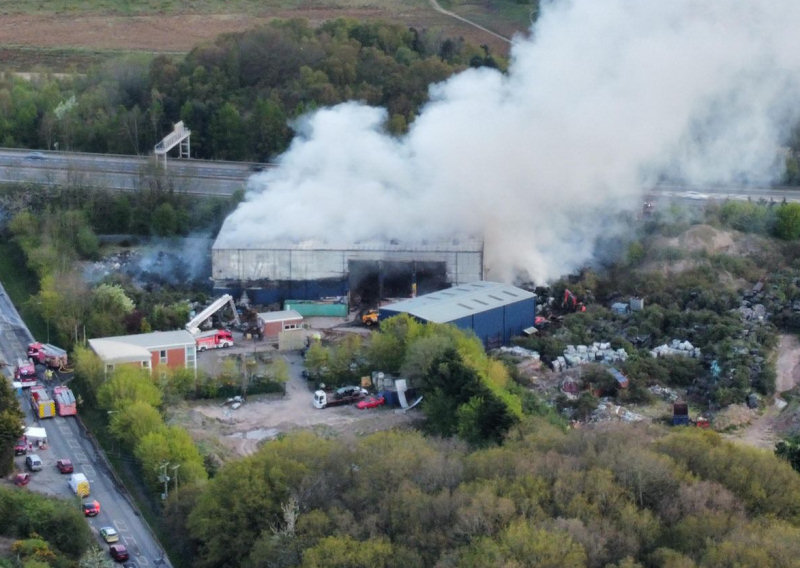 Smoke continues to rise above the scene of the fire at a waste recycling centre in Telford. Photo: James Griffiths