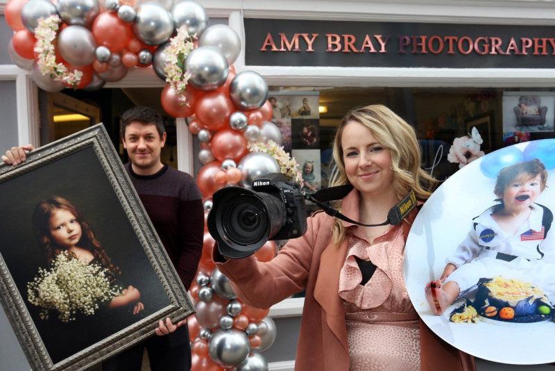 Amy Bray outside her new portrait studio in Wellington with husband Dan