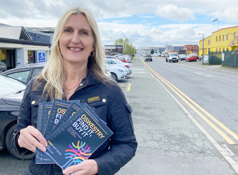 Oswestry BID's Adele Nightingale with samples of 'Oswestry – Find It, Buy it'