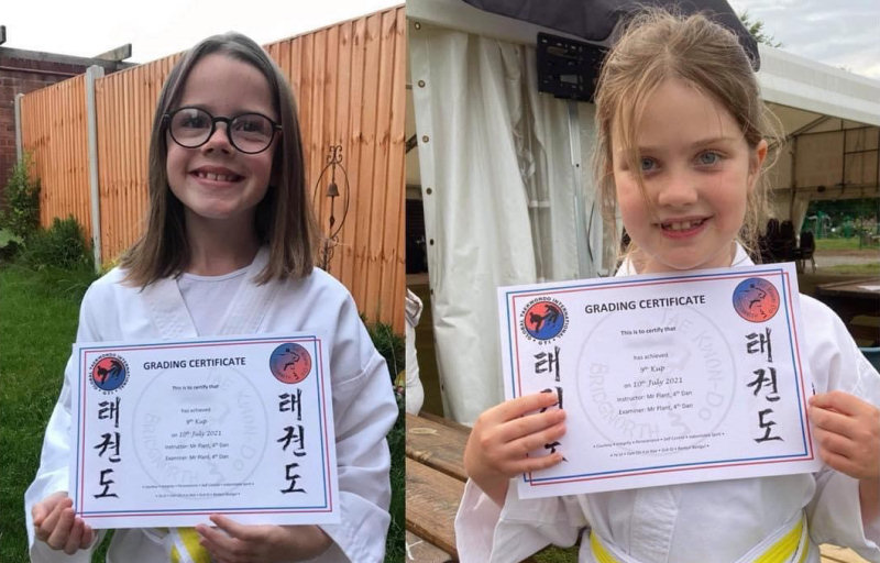 Ava Plant and Ava Edwards with their grading certificates