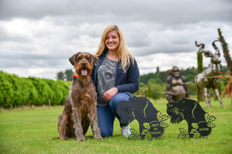 British Ironwork Centre Marketing Manager and GWP Secretary, Alice Turnbull with Chilli along with donated trophies.