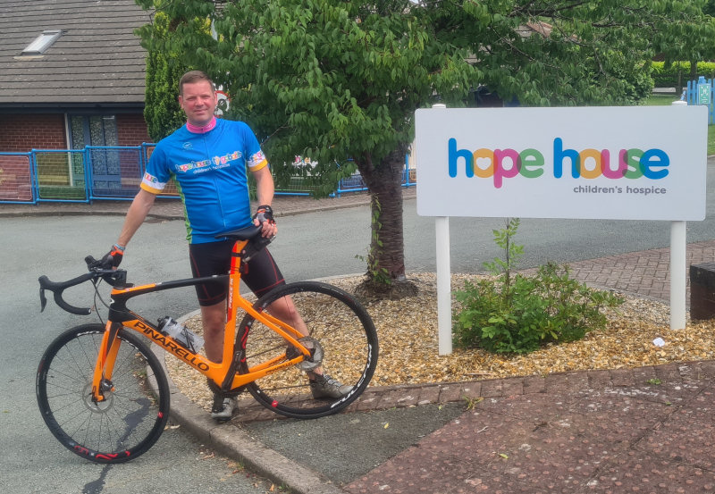 Kenny Hamer is challenging himself to cycle the length of the Welsh coastline to support Hope House