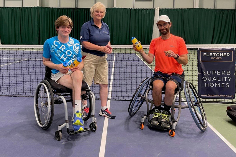 Men's doubles - and singles - winner Ruairi Logan, left, with his doubles partner Mark Langeveld, and tournament referee Janet Asbridge