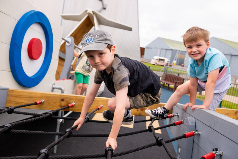 Children enjoying the new RAF Museum Cosford playground. ©Trustees of the Royal Air Force Museum'