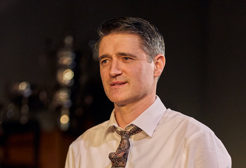 Tom Chambers, stars as the charismatic and manipulative Tony Wendice