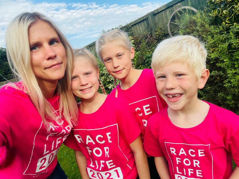 Vicky Baillie with her children Evie, Sophie and Seth who are all taking part in Race for Life in Telford on Sunday in memory of Vicky's sister Deborah Bowness who died in August