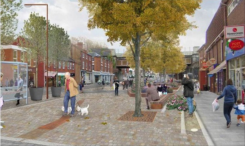 How the street scene may look in a year's time with improved high quality stone paving, new street furniture and a much more user friendly feel to the town centre