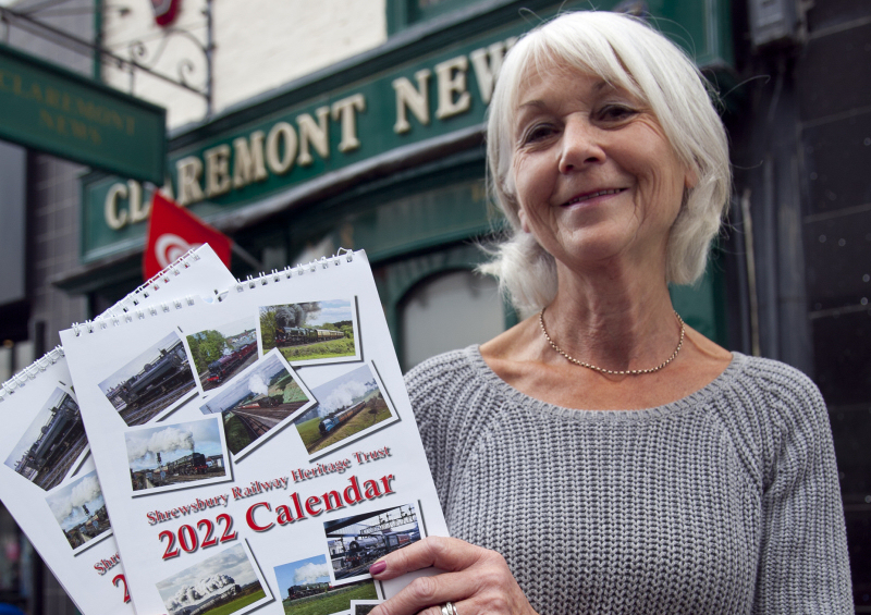 Val Woodvine of Claremont News with the 2022 calendar