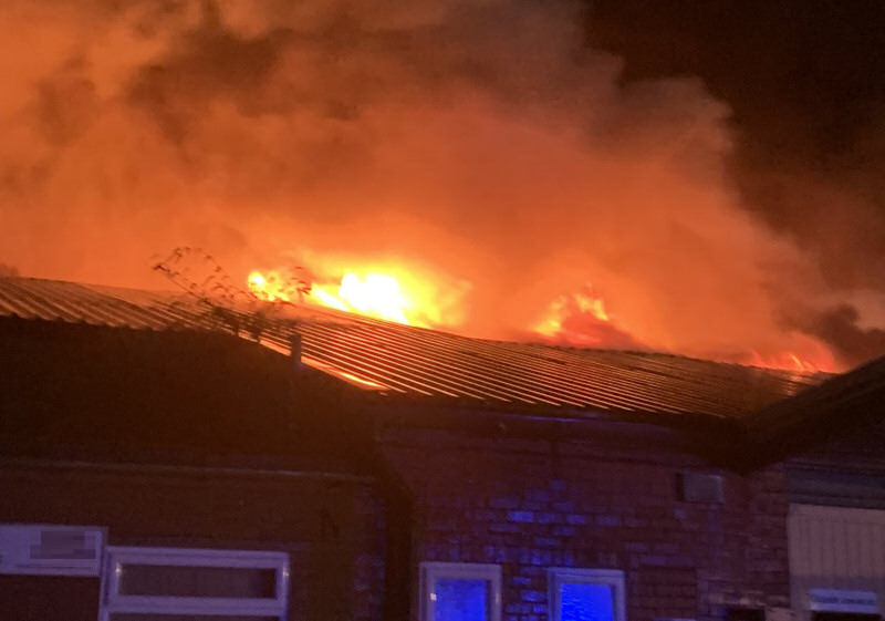 Flames could be seen coming from the roof of the commercial property on Wem Business Park. Photo: @SFRS_Wem